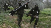 Az Iszlám Dzsihád álarcos fegyveresei rakétákat készülnek kilőni Izrael területé